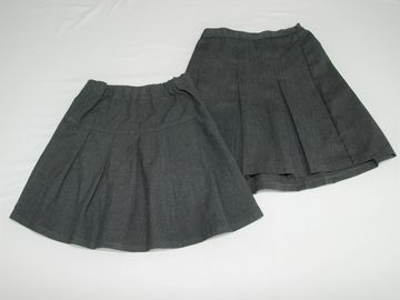 Selling with online payment: Grey Skirts 3-4years 2 pack